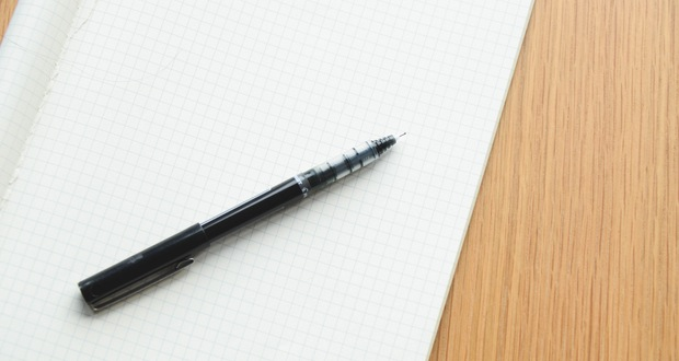 desk-notebook-pen-writing